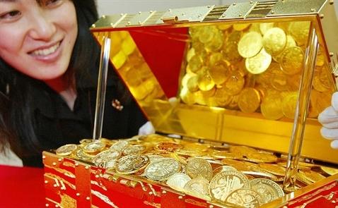 Giá vàng tiếp tục giảm do đồng USD mạnh lên