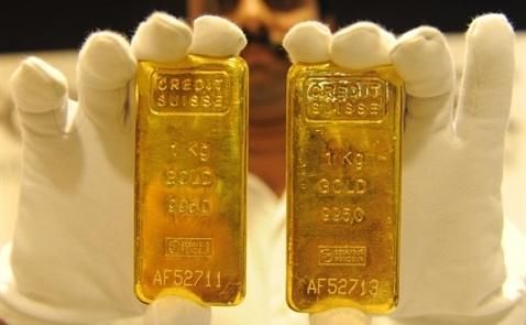 Giá vàng tiến sát mức 1.300 USD/ounce