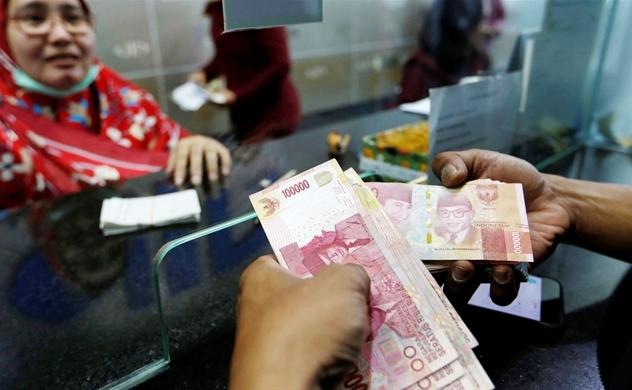 Người dân châu Á khổ vì tiền tệ mất giá