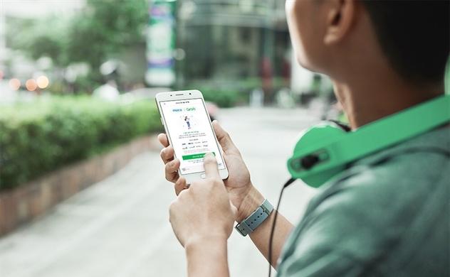 Grab hợp tác với Vietcombank thanh toán không tiền mặt
