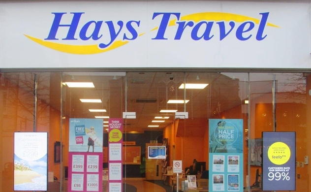 Công ty nào đã mua lại toàn bộ cửa hàng của Thomas Cook tại Anh?
