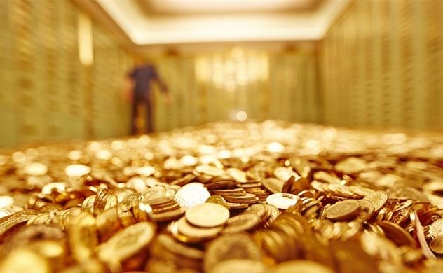 Vàng thế giới vượt ngưỡng 1.700 USD sau 7 năm