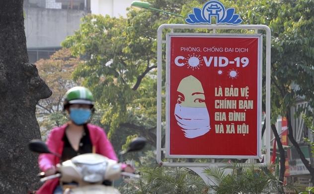 """Việt Nam đã """"làm phẳng đường cong"""" COVID-19 như thế nào?"""