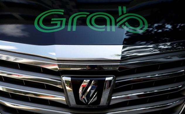 Grab considers U.S. IPO this year to raise at least $2 bln